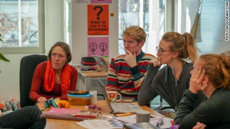 Extinction Rebellion volunteers in a meeting at the London headquarters.