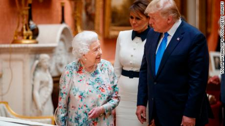 The Queen Elizabeth II views displays of US items of the Royal collection at Buckingham Palace on June 3 with US President Donald Trump and first lady Melania Trump.