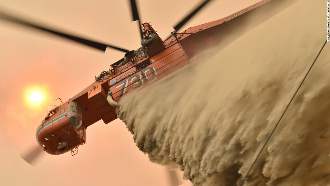 A helicopter drops fire-retardant to protect a property in Balmoral.