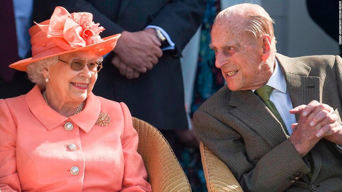 Queen Elizabeth and Prince Philip attend a polo match in Egham, England, in June 2018.