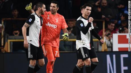 Ronaldo celebrates with defender Leonardo Bonucci and  goalkeeper Gianluigi Buffon.