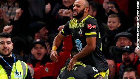 Southampton's Nathan Redmond is lifted by substitute Danny Ings after scoring his side's second goal in the 2-0 Boxing Day victory at Chelsea.
