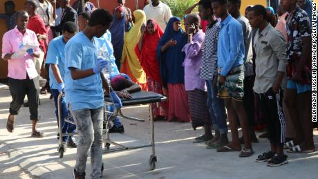 Nurses from Mogadishu's Madina Hospital push a wounded person on a stretcher.