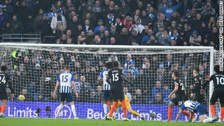 Alireza Jahanbakhsh (second right) is on his knees as his spectacular bicycle kick heads for the Chelsea goal.