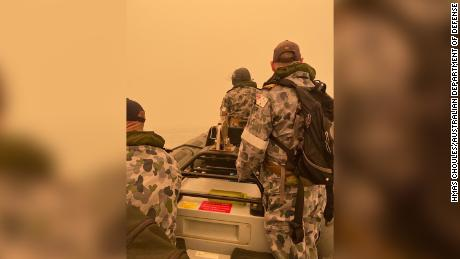 The Australian military assisting with bushfire evacuations.