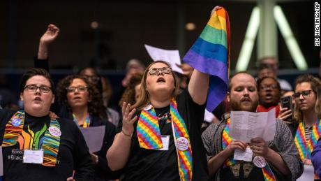 Shelby Ruch-Teegarden, in the center, joins other protesters during the United Methodist Church special session of her general conference in St. Louis on February 26, 2019.