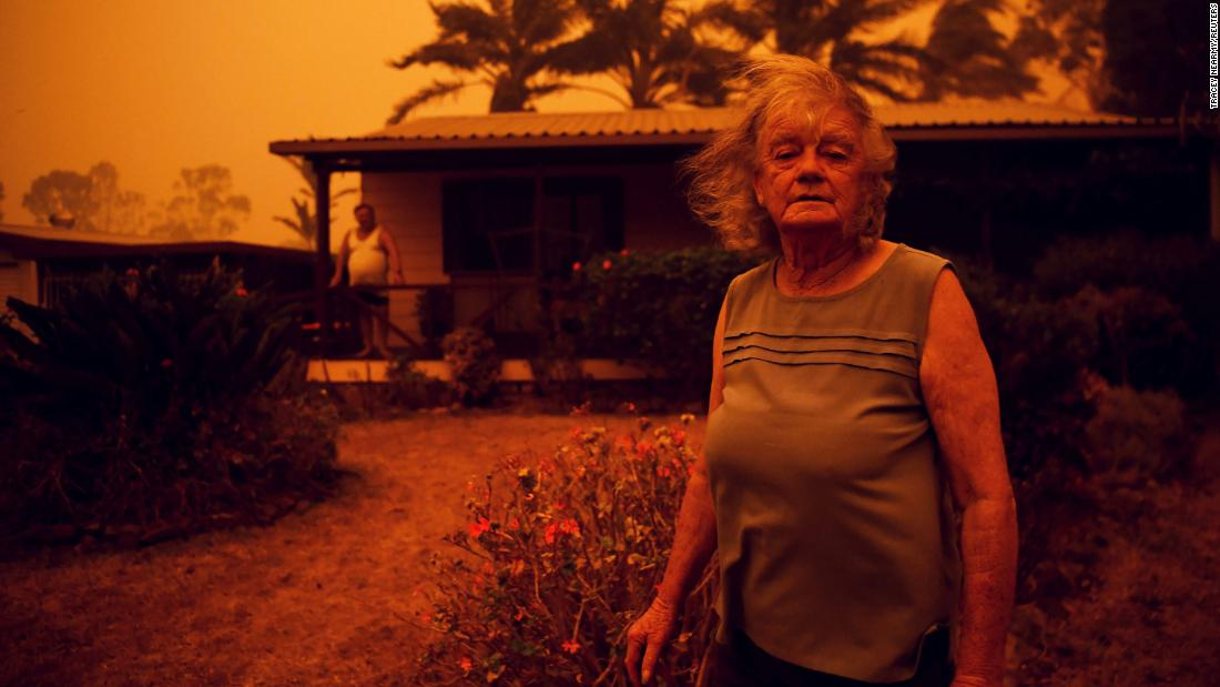 Nancy Allen stands outside her house as high winds push smoke and ash from the Currowan Fire toward Nowra in New South Wales on January 4.