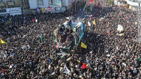 Iranian mourners gather around a vehicle carrying the coffin of slain top general Qasem Soleimani during the final stage of funeral processions, in his hometown Kerman on January 7, 2020.