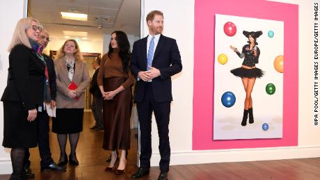 Prince Harry and  Meghan, Duchess of Sussex, view a special exhibition of art by indigenous Canadian artist Skawennati.