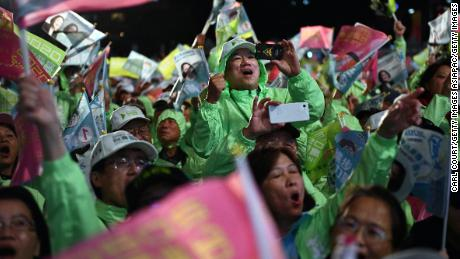 Supporters of Taiwan's current president and Democratic Progressive Party presidential candidate, Tsai Ing-wen, cheer at a rally in Taoyuan on January 8, 2020.
