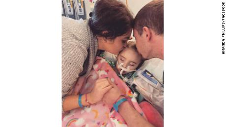 Amanda Phillips and Stephen DeLucia with their daughter, Jade DeLucia, at the University of Iowa Stead Family Children's Hospital.