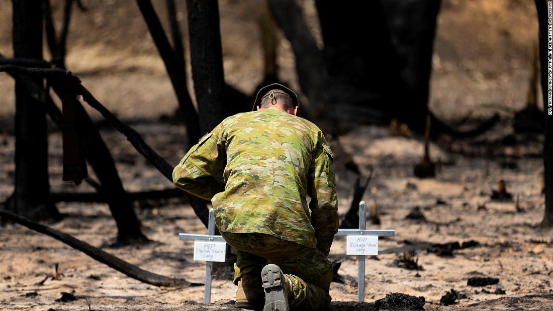 Lt. Kynan Lang from the 10th/27th Battalion visits the scene where his uncle and cousin died in a bushfire on Australia's Kangaroo Island.