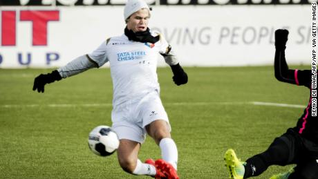 Carlsen is pictured playing football in Velsen-Zuid  prior to a chess tournament in 2017.