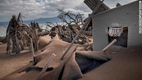Houses near Taal Volcano's crater are seen buried in volcanic ash in Taal Volcano Island.