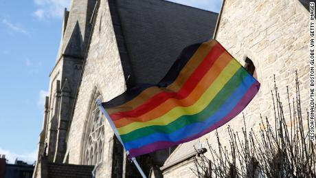 An LGBTQ flag flies over the United Methodist Church in Boston on January 5, 2020.