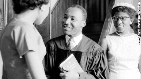 King speaks to people after giving a sermon on May 13, 1956, in Montgomery, Alabama.