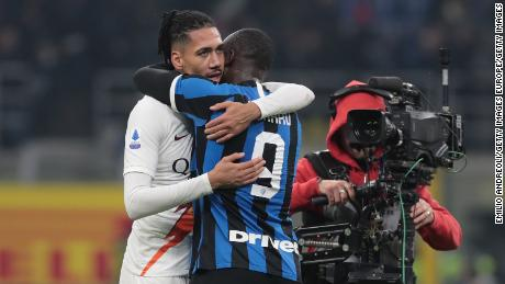 """Chris Smalling and Romelu Lukaku embraced after the December match between Inter Milan and Roma following the Corriere dello Sport's widely condemned """"Black Friday"""" headline ahead of the game."""