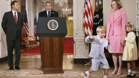 Federal Court of Appeal Judge John G. Roberts Jr. (son) John (3rd R) dances while United States President George W. Bush (C) announces Roberts as his first Supreme Court candidate during a prime time speech July 18, 2005 from the White House in Washington as Roberts Jane's wife (2nd R), duaghter Josephine (R).