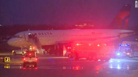 Chicago flights halted; plane slides off Kansas City taxiway