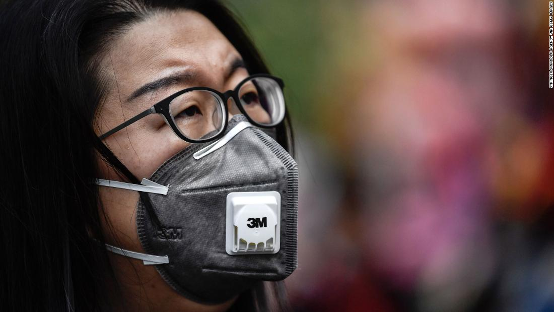 People in Guangzhou, China, wear protective masks on January 22.