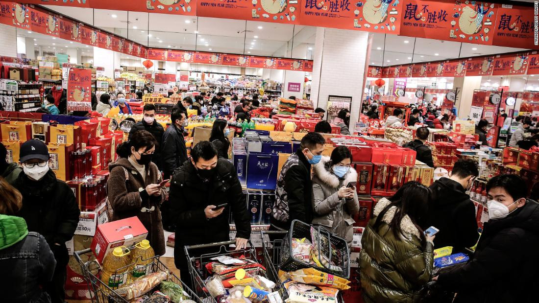 Shoppers wear masks in a Wuhan market on January 23.