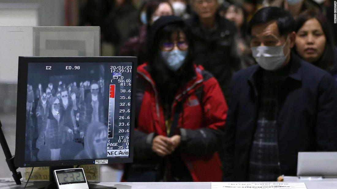 Passengers are checked by a thermography device at an airport in Osaka, Japan, on January 23.
