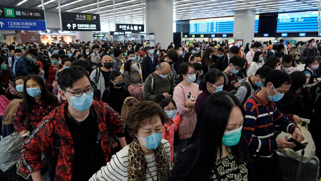Passengers wear masks at the high-speed train station in Hong Kong on January 23.