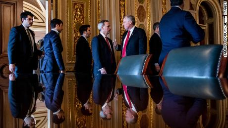 White House Counsel Pat Cipollone (center left) and Representative Mark Meadows (R-NC) (center right) as they leave their meeting with the rest of President Donald Trump's defense team