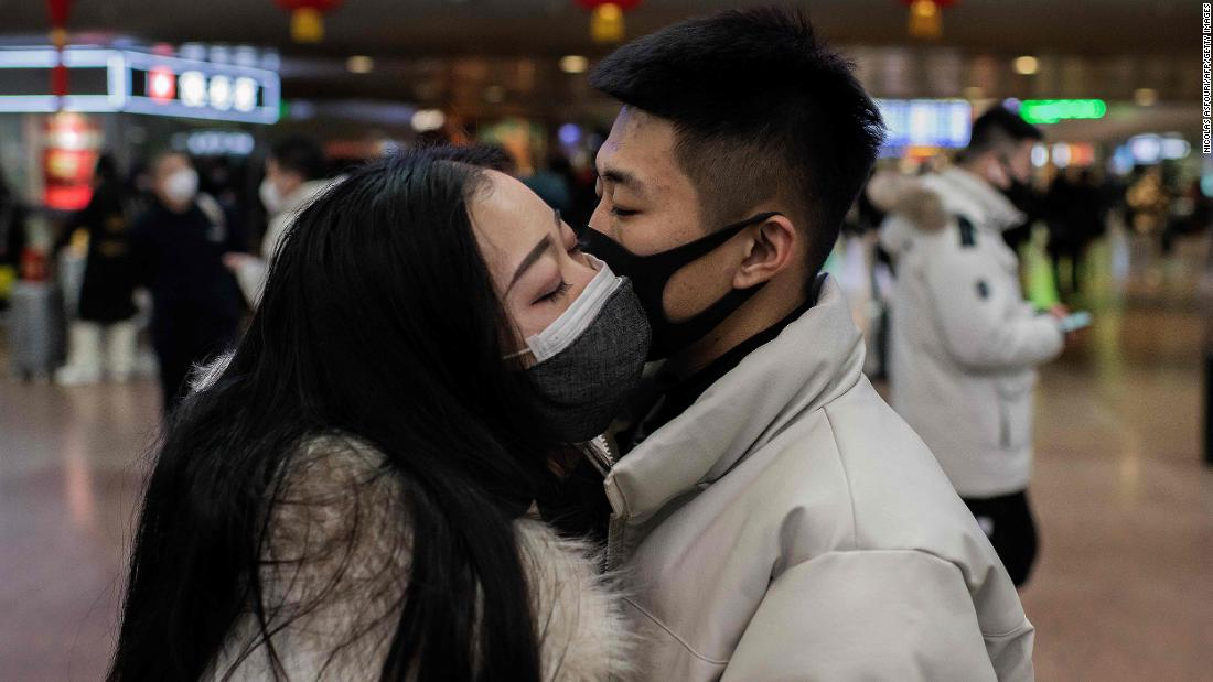 A couple kisses goodbye as they travel for the Lunar New Year holiday in Beijing on January 24.