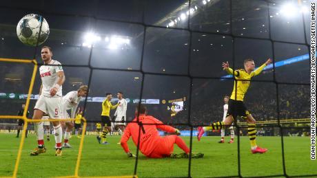 Håland celebrates after scoring  Dortmund's fourth goal against Koln.