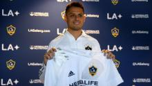 Hernandez poses with his jersey during a press conference.
