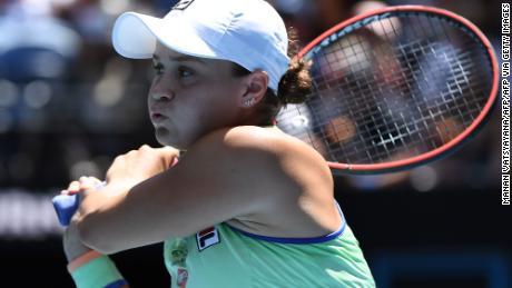 Australia's Ashleigh Barty hits a return against Czech Republic's Petra Kvitova during their women's singles quarterfinal match at the Australian Open tennis tournament in Melbourne on January 28, 2020.