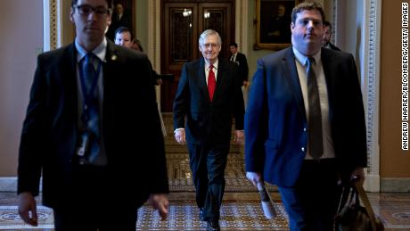 Senate Majority Leader Mitch McConnell, a Republican from Kentucky, center, arrives to the US Capitol on Tuesday, January 21.