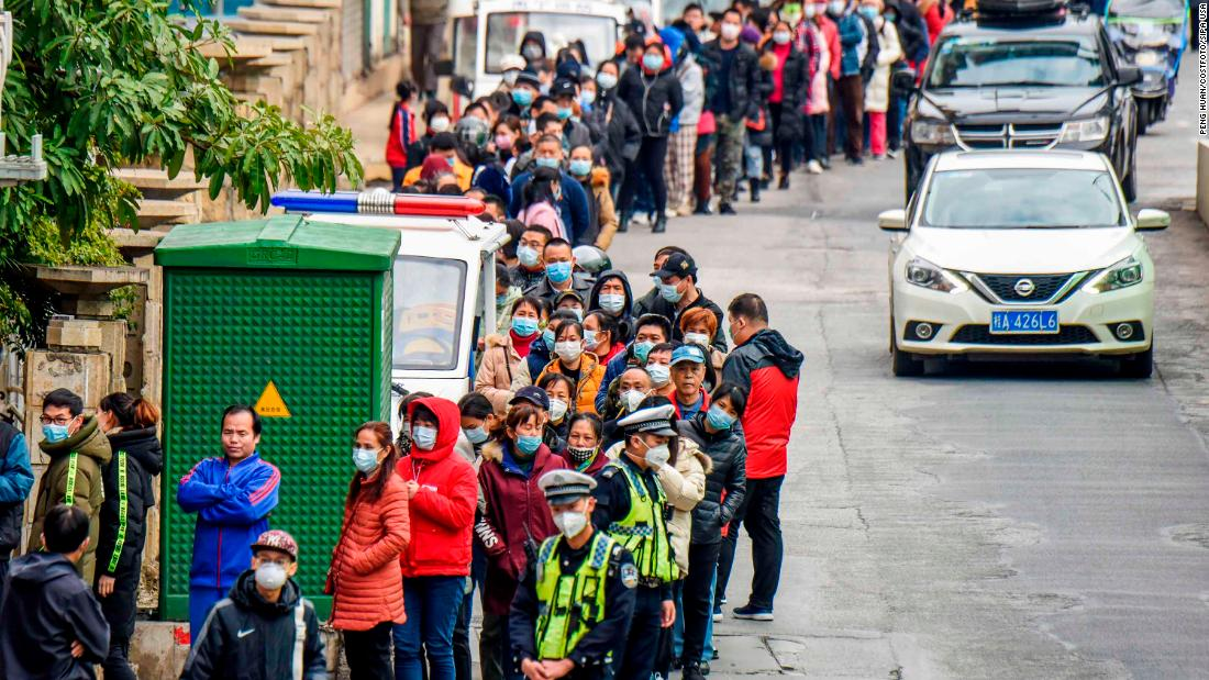 Nanning residents line up to buy face masks from a medical appliance store on January 29.