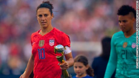 Carli Lloyd holds the World Cup during the US victory tour against Portugal.