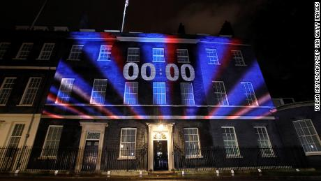 A digital Brexit countdown clock projected on to the front of 10 Downing Street showed 00:00 as the UK left the EU at 11 p.m. Friday local time.