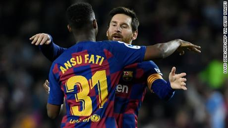 Ansu Fati celebrateshis goal with Lionel Messi.