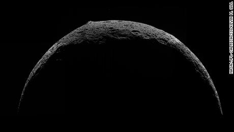 Top left, view of the equatorial mountain ridge on Saturn's moon Iapetus, taken by Cassini in 2007.