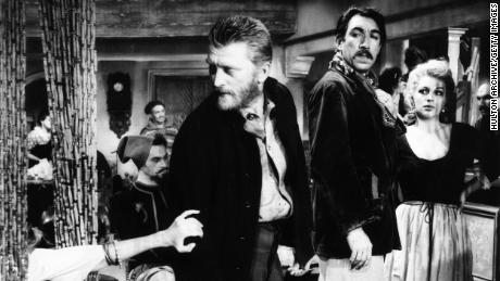 1956:  American actor Kirk Douglas (left) and actor Anthony Quinn (1915 - 2001; right) in a still from director Vincente Minnelli's film 'Lust for Life', in which Douglas plays Vincent Van Gogh and Quinn plays Paul Gauguin.