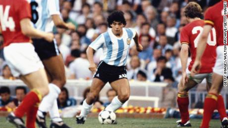 Maradona takes on the Belguim defence during the 1982 FIFA World Cup.
