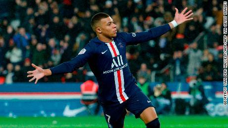 Kylian Mbappe celebrates scoring against Lyon.