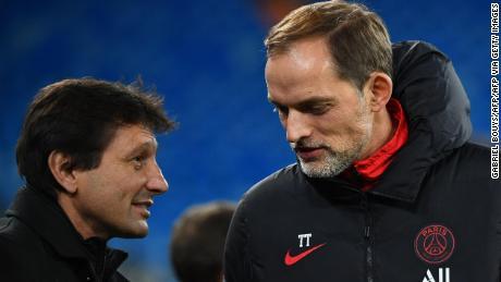 Leonardo (left) speaks with PSG coach Thomas Tuchel ahead of the Champions League match against Real Madrid.