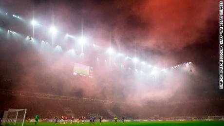 AC Milan's supporters light smoke bombs during the dramatic derby.