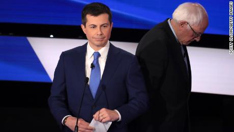 Pete Buttigieg and Sanders take a break during the Democratic presidential primary debate at Drake University on January 14, 2020 in Des Moines, Iowa.