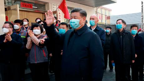 Chinese President Xi Jinping tours a neighborhood in Beijing on February 10.