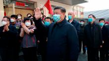 Chinese President Xi Jinping wearing a protective face mask waves as he inspects the novel coronavirus pneumonia prevention and control work at a neighbourhoods in Beijing on February 10.