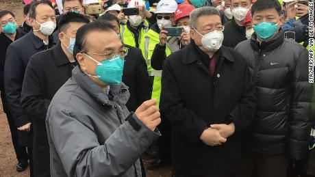 Chinese Premier Li Keqiang speaks as he visits a construction site of a new hospital being built to treat patients of a deadly virus outbreak in Wuhan in China's central Hubei province on January 27.