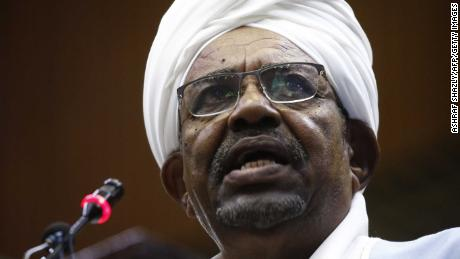 """Sudanese President Omar al-Bashir addresses parliament in the capital Khartoum on April 1, 2019 in his first such speech since he imposed a state of emergency across the country on February 22. - Bashir acknowledged that the demands of protesters demonstrating against his government were """"legitimate' but were expressed unlawfully causing several deaths. (Photo by ASHRAF SHAZLY / AFP)        (Photo credit should read ASHRAF SHAZLY/AFP via Getty Images)"""