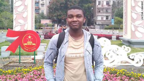 """Nigerian student Victor Vincent pictured at a scientific symposium in Hunan, China, shortly before the coronavirus outbreak. """"At the time, no one was worried and people were making plans never knowing what the future holds. Within days everything changed,"""" he said."""