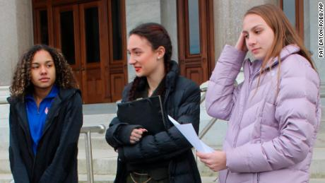 High school track athletes Alanna Smith, left, Selina Soule, center and and Chelsea Mitchell prepare to speak at a news conference outside the Connecticut State Capitol in Hartford, Connecticut, on February 12.